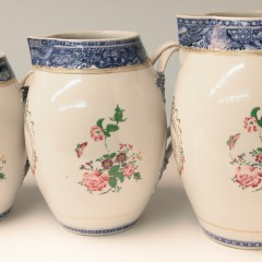 Set of Three 18th Century Chinese Export Graduated Famille Rose Jugs