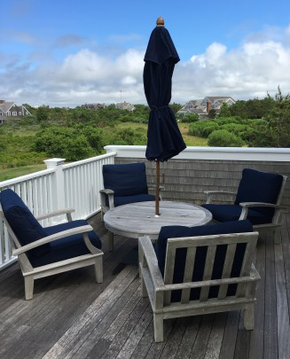Set of Four Gloster Ventura Teak Chairs and Table, with navy upholstered cushions and navy blue umbrella
