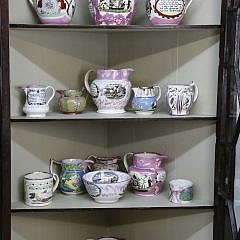 Collection of Sutherland Ceramics and Display Cabinet