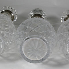 Three Clear Crystal Decanters with Sterling Collars