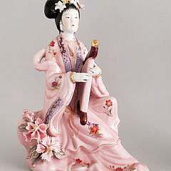 Four Chinese Porcelain Geisha Figurines