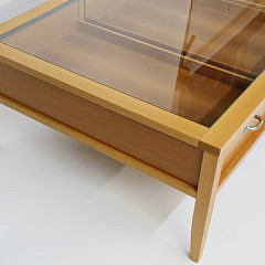 Contemporary Three Drawer Glass Top Display Cocktail Table