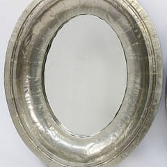 Two Riveted Silver Gilt Oval Mirrors
