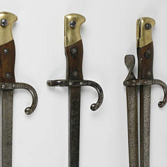 Set of Three French Walnut Forged Steel and Brass Bayonet Fire Tools, 19th century