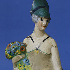 Cast Iron Painted Doorstop of a Lady with Flower Bouquet