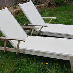 Pair of Gloster Teak Chaise Lounges and Side Tables
